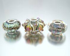Silver core charm beads by Susan Lawson Lampwork Glass Beads on Flickr