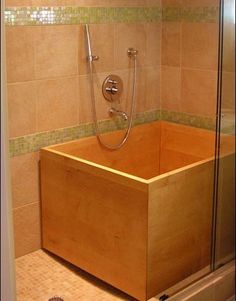 """A Maple Ofuro designed for a walk-in shower space. The tub drains down to shower floor requiring no plumbing. Tub is 45"""" x 35"""" x 27"""" high."""