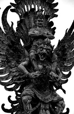 Garuda - is a large mythical bird or bird-like creature that appears in both Hindu and Buddhist mythology.  I do not know where this statue is.