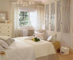 great way to class-up the built-in his/hers closets in our bedroom: glass doors with curtains!