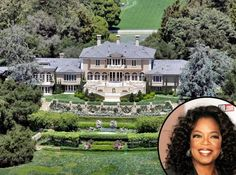 """Oprah Winfrey's estate is located in Santa Barbara, California. The property covers approximately 42 acres and the house is 23,000 square feet. It has 6 bedrooms, 14 bathrooms, 10 fireplaces and theatre. Oprah added a an-made lake srocked with rare fish and she had local Montecito sandstone bricks hand-laid into a quarter-mile long driveway. Although this house is nicknamed """"Oprah's Hearst Castle"""", we like it because of the landscaping, which is meticulous"""
