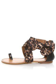 """Make room for the Bamboo Bloom 33 Natural Leopard Satin Side Bow Flat Sandals! Satiny fabric upper in this season's must-have leopard print looks effortlessly chic with pleats and a big bonny side bow at the ankle. Cupped heel in black faux leather has 3"""" zipper, plus elastic at instep and inner ankle for a cozy fit. Flat sole has 1/4"""" stacked wood-look heel. Leather insole with dark brown top-stitching. Non-skid, rubber flex sole. Available in whole and half sizes. Fit is ..."""