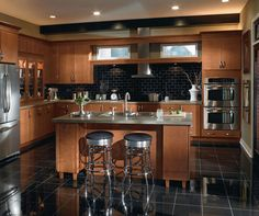 The rich tones of these contemporary Maple kitchen cabinets keep things down-to-earth and inviting.