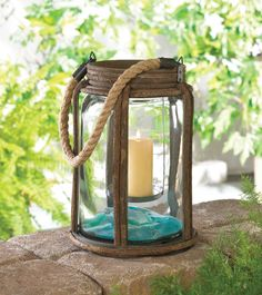 Easily add charm and vintage style to any space with this rustic lantern featuring a rope handle, wooden twig frame and interior glass that looks like a canning jar. No need to spend hours scouring antique shops! #freeshipping