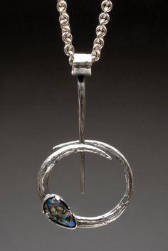 Circular Motion Sterling Silver Necklace with Boulder Opal and Sapphire Charm