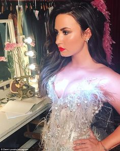 Wow: Demi Lovato shared this arresting image of a light on her chest to her Instagram account on Wednesday