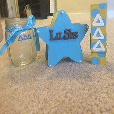 "Tri Delta Handmade Little Gifts Tri Delta handmade little gifts! Perfect add on to some tees from my closet! Items include: mason jar with deltas, blue and yellow star container with pearls and ""lil sis"" letters, yellow big clip with blue polka dots and white letters. Accessories"