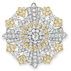 A DIAMOND BROOCH, BY DAVID WEBB  Designed as a circular and old European-cut diamond openwork plaque, mounted in 18k gold and platinum, with pendant hook and hoop for suspension, circa 1965