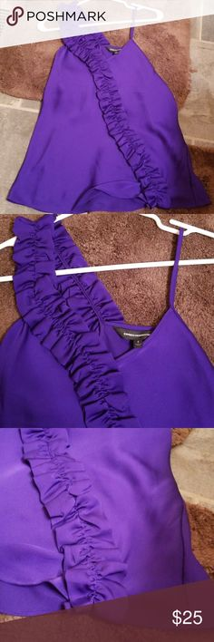 NWOT. Beautiful women's top! Tags off but never worn. My loss is your gain!! Radiant purple color!! Silky material and doesn't wrinkle! Express Tops