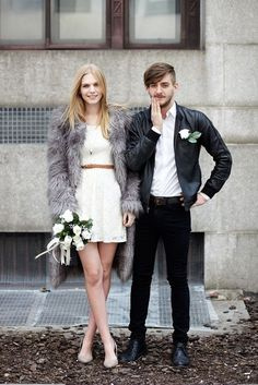 Funky Fur: This couple nailed their wedding look. The bride wore a faux fur coat over her lace short wedding dress while the groom rocked a leather jacket instead of the classic tux.