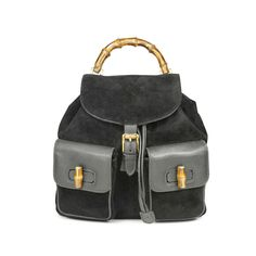 454ab06330b0 Vintage Gucci Bamboo Backpack designed with the signature Bamboo handle and  turn clasps that the house