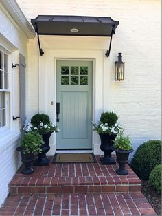 Front Door Paint Colors - Want a quick makeover? Paint your front door a different color. Here a pretty front door color ideas to improve your home's curb appeal and add more style! Front Door Awning, Front Door Planters, Front Door Entrance, Exterior Front Doors, Front Entry, Urn Planters, Front Door Canopy, Black Planters, Door Entry