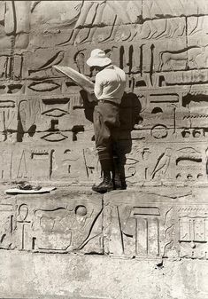 Deciphering and recording hieroglyphs, Egypt.
