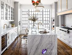 Glamorous White Kitchen Designed by Interior Designer Bria Hammel This glamorous white kitchen, designed by Bria Hammel has a Wolf cooktop and ovens that let the homeowners cook on one side of the kitchen while, on the opposite wall, a wet bar with a wine refrigerator caters to entertaining.<br> This glamorous white kitchen, designed by Bria Hammel has a Wolf cooktop and ovens that let the homeowners cook on one side of the kitchen while, on the opposite wall, a wet bar with a wine… Rustic Kitchen Design, Home Decor Kitchen, Eclectic Kitchen, Interior Design Tips, Interior Design Kitchen, Luxury Interior, Interior Paint, Traditional Kitchen, Traditional House