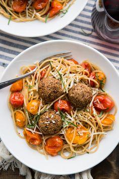 Lentil Meatballs with Burst Tomato Pasta | @naturallyella