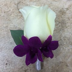 #beachboutonniere #boutonniere #beachweddingflowers #beachwedding #rose #orchids #PensacolaFlorist #PensacolaWeddingFlorist #PensacolaWeddingFlowers