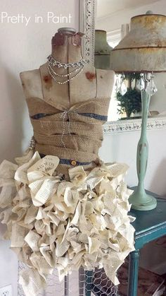 Skirt made out of book pages and chicken wire... www.prettyinpaintblog.blogspot.com #Dressform #DIY #Shabbychic