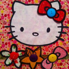 Hello Kitty Busy/Quiet Book Page.  Flower, bows, and star attach with snap at ear, and when not in use are stored on snaps on the ribbon at the bottom of the page.
