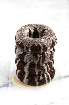 Rich chocolate donuts with a sweet glaze - so delicious and the best part is, they're vegan! #donuts #vegan