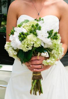 White hydrangea and hypericum berries.