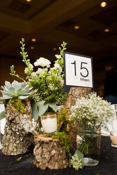 table deco at daughter's wedding -- we did the glass & wood, Bouquets of Austin did the succulents & flora