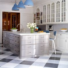 Mixing black and white tiles with gray ones keeps this beautiful kitchen light and airy.