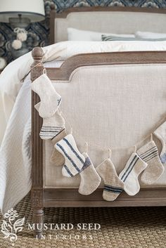 These neutral stockings are actually recycled pieces of grain sacks. Painted blue and white, they make for a pretty garland that doesn't disrupt the vibe of this space. Get the tutorial at Miss Mustard Seed »