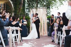 Ribbon backdrop for the ceremony.  Photograph by Heather Curiel Photography.