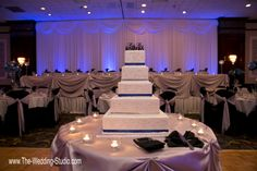 """Wedding Cake table. White wedding cake with blue ribbons topped with the newlyweds """"Mr & Mrs"""" last name at The Mirage Banquets in Schiller Park. Photographed by The Wedding Studio, Schaumburg IL"""