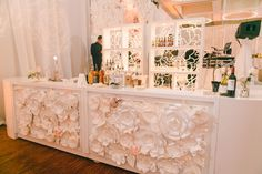 Bar Decor - our paper flowers worked perfectly to soften the bar fronts.  Colors: Blush pink & white/ivory www.pkpaperart.com