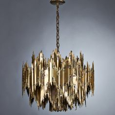 Lot No. 858 Tom Green Brutalist seven-light chandelier, 1960s; Hand-torched patinated brass; Unmarked