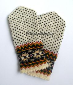 Hand knitted wool mittens.Warm mittens.Autumn colors. Autumn colors pattern on the white background.Christmas gift idea.Autumn gift idea.