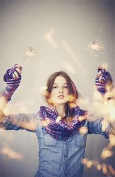 Like the sparkler idea. What IS on her hands?