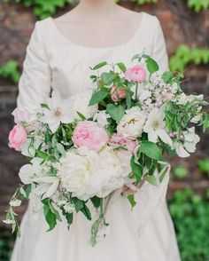 Poppies & Posies created a bouquet featuring peonies and garden roses in a color scheme of blush and cream for Cristina.
