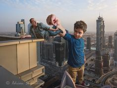 Adrian Sommeling's vividly detailed images star his son as a giant who toys around with famous landmarks.