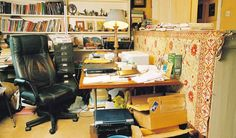 This office is a bit too cluttered for my taste.