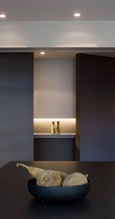 The use of black panels to frame a millwork feature by interieurarchitect Frederic Kielemoes. lovely.