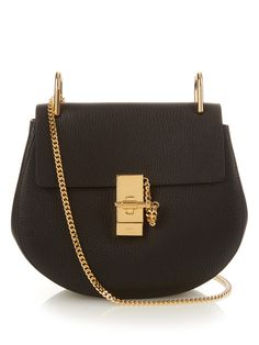 Introduce elegance and polish to your every look with Chloé's black grained lamb-leather Drew bag.The signature horseshoe shape is accented with gold-tone metal hardware that's inspired by jewellery designs, and is lined with soft suede in the compact interior. Carry it from day to night via the dainty chain shoulder strap.