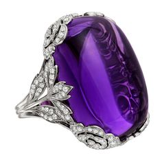 Large Cabochon Amethyst Diamond White Gold Ring | From a unique collection of vintage cocktail rings at https://www.1stdibs.com/jewelry/rings/cocktail-rings/