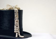 Early XX century Italian hat, made in Milan and '40s sophisticated bijoux pearl necklace with ribbon elaborated decoration.