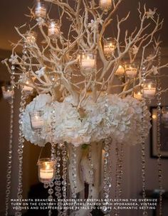 Table Centrepiece:  Manzanita tree with hanging votives, crystal beads and flowers.