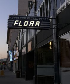 "hey hey, check it out, I bet you've never seen ""Flora"" put up in neon."