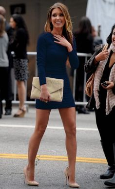 Long-sleeved navy dress with nude heels