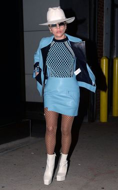 Lady Gaga shows off her style in a blue ensamble, white hat + boots, and round sunnies with gradient lenses.