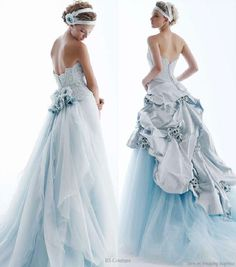 Light baby blue wedding gown with bustle detail from RS Couture by Renato Savi