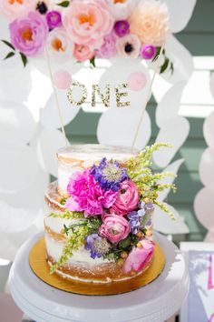 Gorgeous 1st birthday cake in this pretty garden bday party on www.prettymyparty.com.