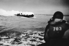 Smoke streams from a U.S. coast guard landing craft approaching the French Coast on June 6, 1944 after German machine gun fire caused an explosion by setting off an American soldier's hand grenade.