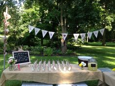 Bar for outdoor wedding shower, instead of using glasses, use mason jars