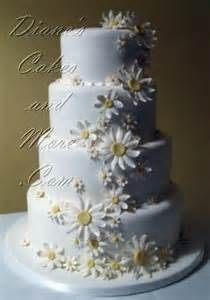 Daisy cake would look nice on wooden cake stand.