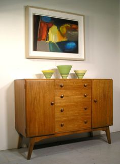 Anonymous; Walnut 'Golden Key' Cabinet by Palatial, 1950s.